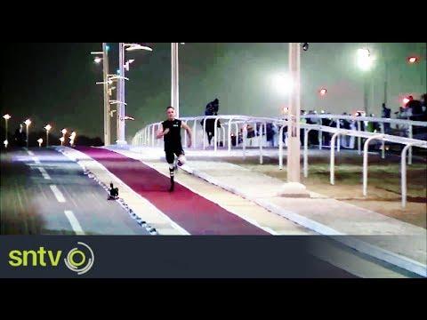 Oscar Pistorius races a horse