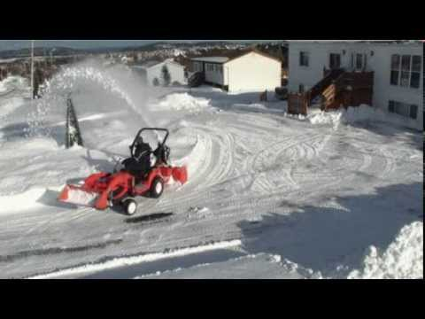 Kubota BX snow blower throws snow far