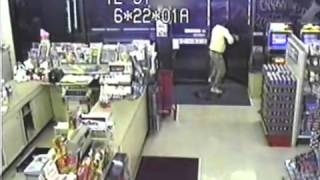 Shopkeeper turns gun on robber   stupid thief puts his gun down!