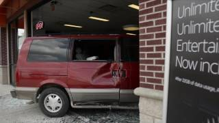 Car crashes into AT&T store