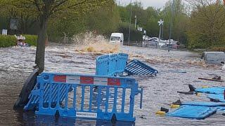 Burst Water Main Floods Residential Road
