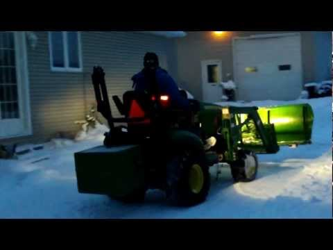 john deere 1026r plowing snow 2