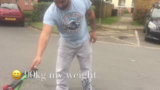 96kg Man On A Kids Quad 49cc Zipper