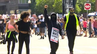 Protesters clash with police after