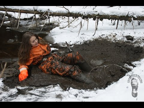 Mud session (Darina in orange rainwear)