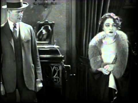 """A scene from the 1928 film """"Lights of New York,"""" with Robert Elliott, Gladys Brockwell, Cullen Landis and Eugene Pallette. For more information, visit moviedavid.blogspot.com!"""