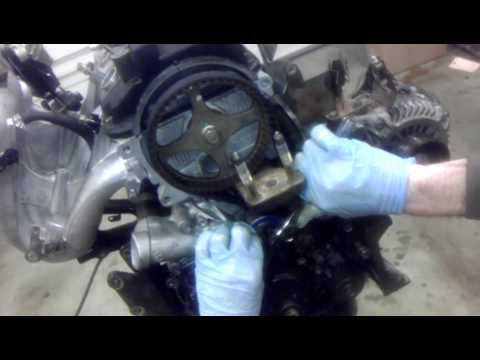 How to install timing belt on a 4g69 engine. 2006 Mitsubishi Eclipse Part 2