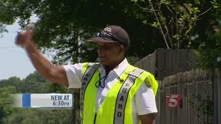 Crossing Guards Say They Take Their Job Seriously