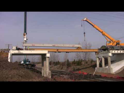 Jcrane sets bridge beams over railroad