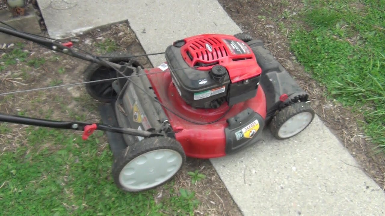 how to change spark plug on troy bilt push mower