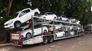 Descarregando carreta cegonha só carros grande