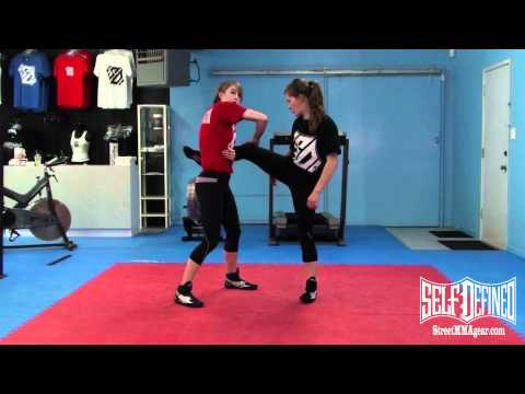 Single Leg Takedown from Kick: Women's Beginner MMA Wrestling Technique Image 1