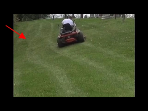 MOWING SKETCHY HILLS AT THE CEMETERY - lawn care - mowing business - vlog