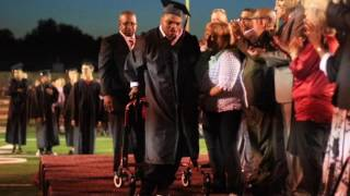 Graduate with cerebral palsy walks for the first time so amazing