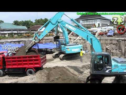 Excavator Kobelco SK200 Digging Loading Dump Truck Toyota Dyna