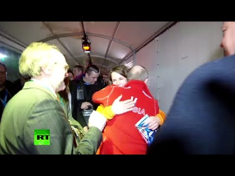 Video: Putin hugs gay athlete, speaks German, drinks beer in Sochi