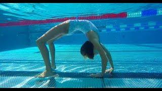 Carla underwater doing underwater gymnastics