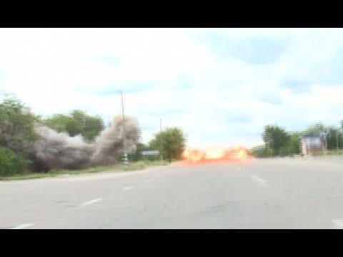 RAW: Moment of shell explosion hit Russian TV crew in E.Ukraine