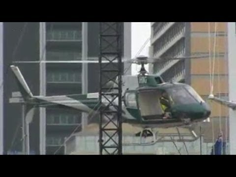 Pilot fall down from chrashed helicopter and survive