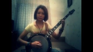 "Janna plays ""June Apple"" (banjo)"