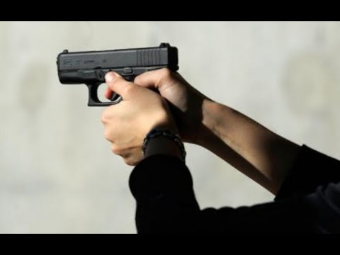 Students Pose For Yearbook Photos With Guns