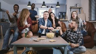 Friends Watch Sports on TV, Cheer and Celebrate. Happy Diverse Supporters Fans Sit on Couch with |