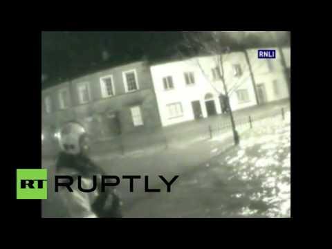 UK: Rescue teams wade through flood waters as Storm Desmond batters UK