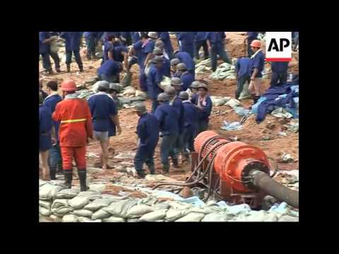 China says mining accident that trapped 181 workers was a natural disaster