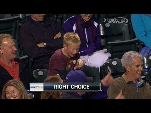 A young fan can't believe he has a foul ball