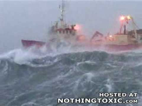 Ship in big waves at sea