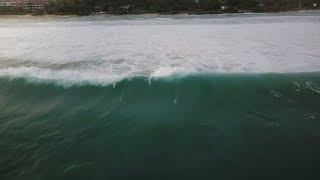 Drone Camera Follows Huge Blue Ocean Foamy Wave Rushing To Beautiful Exotic Resort Shore with |