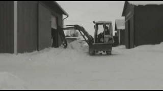 Snow removal with Kubota KX71 mini excavator