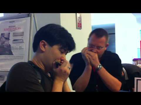 Zhin and Brendan Power jam at the Asia Pacific Harmonica Festival