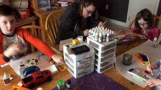 A Family Building Models Together On Saturday Morning