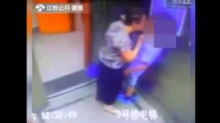 Shoking CCTV footage of lady forcing to kiss young boy in a lift sparks outrage || Video 2015