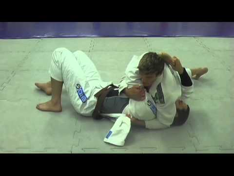Jiu Jitsu techniques - Choke Set Up from Side Control, Using Gi Apron, with Armbar Follow Up - BJJ Image 1
