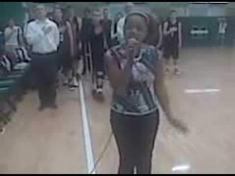 Kesha singing national at the Muskogee High School