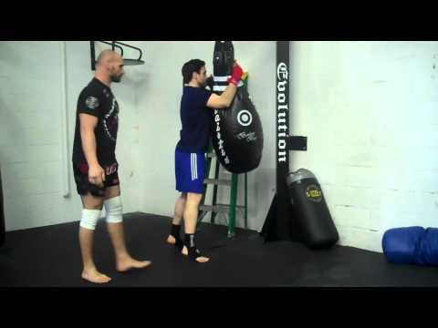 MUAY THAI CLINCH TRAINING ON TEAR DROP BAG Image 1