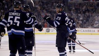 Laine rips one-timer stick side past Lack