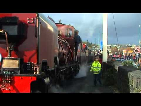 The first passenger train arrives from Caernarfon arrives at Porthmadog on 30th October 2010 ahead of the official opening of the WHR line in April 2011. A m...