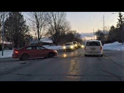 Road rage ensues after angry woman makes improper left turn then gets hostile