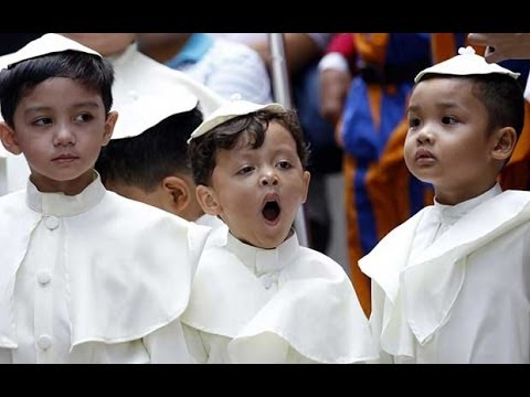 'Mini-Popes' tour Manila in old Popemobile to celebrate canonisation ceremony