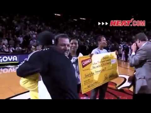 LeBron James hugs Miami Heat fan that hits $75k half-court shot