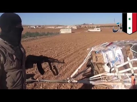 New ISIS video shows US supplies airdropped into the hands of the Islamic militants thumbnail