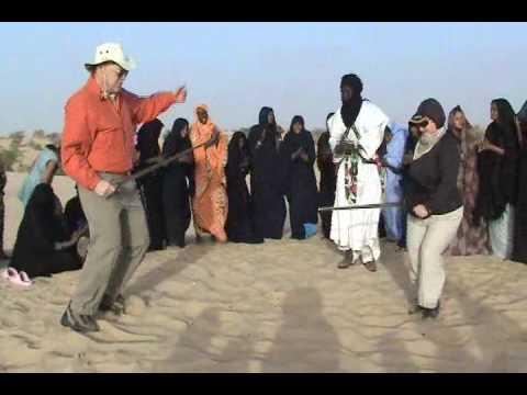 Tuareg women musicians with strange dancers, Timbuktu, Mali
