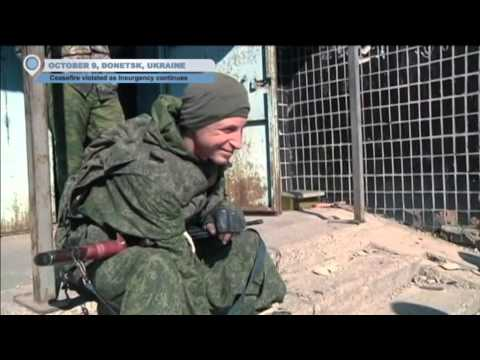 Battle for Donetsk Airport: Kremlin-backed insurgents continue to attack despite ceasefire