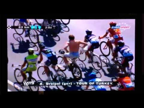 Andre Greipel changing shirt while cycling at Tour of Turkey