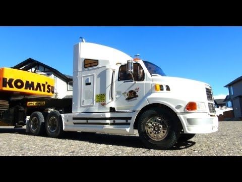 RC ADVENTURES - Ford AeroMax 1/14th 6X4 Semi Truck hauling Excavator on Trailer