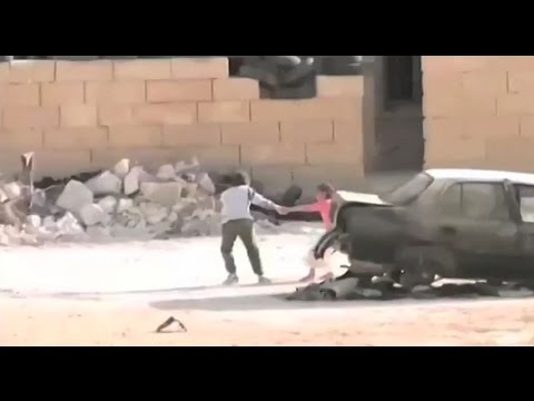 SYRIA! SYRIAN HERO BOY rescue girl in shootout  الطفل السوري البطل