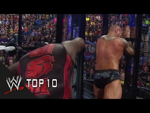 WWE Top 10 looks back at the most brutal and destructive moments in Elimination Chamber history.